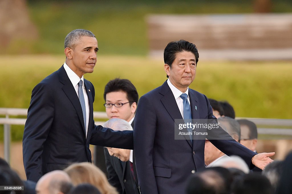 U.S. President Barack Obama (L) and Japanese Prime Minister Shinzo Abe (R) visit the Hiroshima Peace Memorial Park on May 27, 2016 in Hiroshima, Japan. It is the first time U.S. President makes an official visit to Hiroshima, the site where the atomic bomb was dropped in the end of World War II on August 6, 1945.