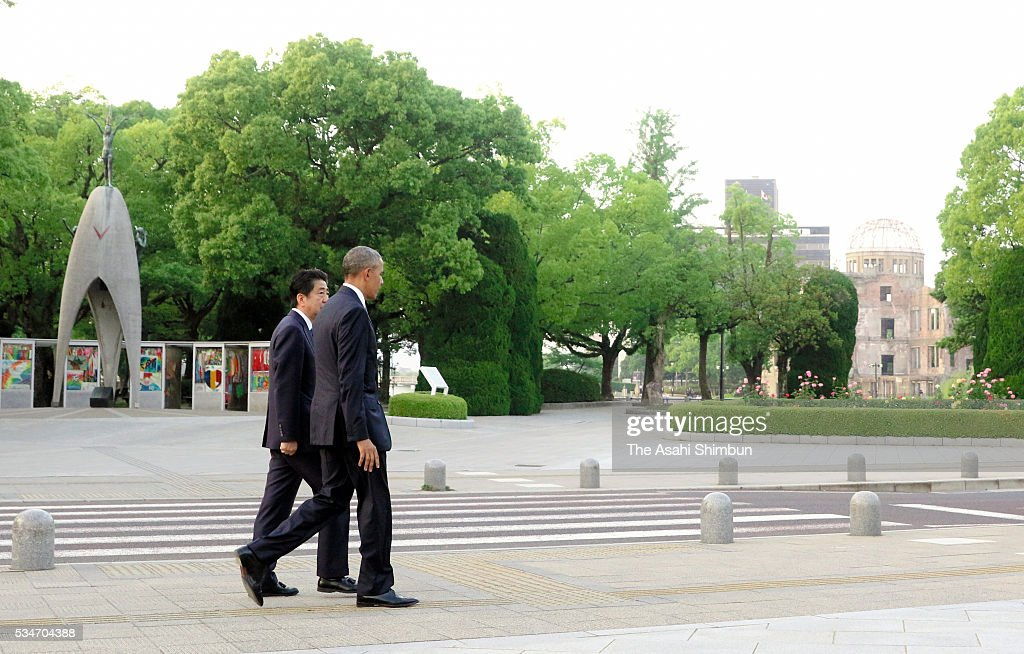 U.S. President Barack Obama and Japanese Prime Minister Shinzo Abe walk at the Hiroshima Peace Memorial Park on May 27, 2016 in Hiroshima, Japan. Obama becomes the first sitting U.S. president to visit Hiroshima, where the first atomic bomb was dropped in 1945 at the end of World War II.