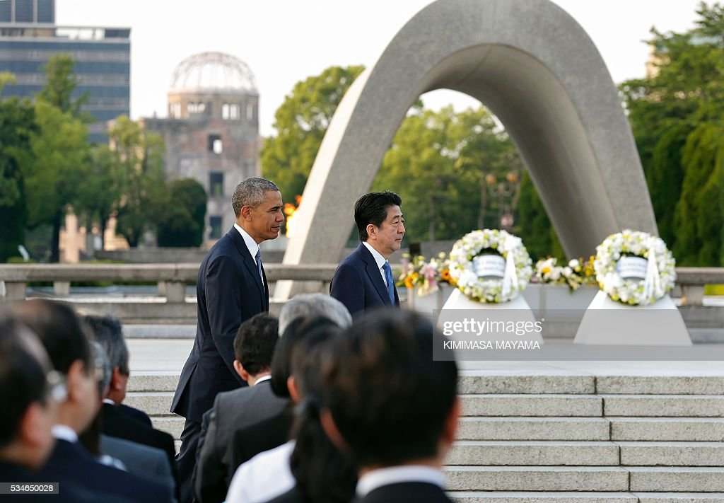 US President Barack Obama (L) and Japanese Prime Minister Shinzo Abe walk towards atomic bombing survivors after delivering their speeches and laying wreaths in front of a cenotaph to offer a prayer for victims of the A-bomb in 1945, at the Hiroshima Peace Memorial Park on May 27, 2016. Obama on May 27 paid moving tribute to victims of the world's first nuclear attack. / AFP / POOL / KIMIMASA