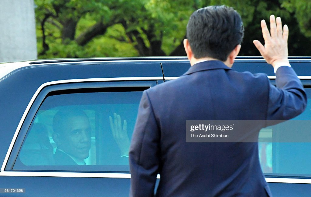 U.S. President <a gi-track='captionPersonalityLinkClicked' href=/galleries/search?phrase=Barack+Obama&family=editorial&specificpeople=203260 ng-click='$event.stopPropagation()'>Barack Obama</a> and Japanese Prime Minister <a gi-track='captionPersonalityLinkClicked' href=/galleries/search?phrase=Shinzo+Abe&family=editorial&specificpeople=559017 ng-click='$event.stopPropagation()'>Shinzo Abe</a> wave on departure at the Hiroshima Peace Memorial Park on May 27, 2016 in Hiroshima, Japan. Obama becomes the first sitting U.S. president to visit Hiroshima, where the first atomic bomb was dropped in 1945 at the end of World War II.