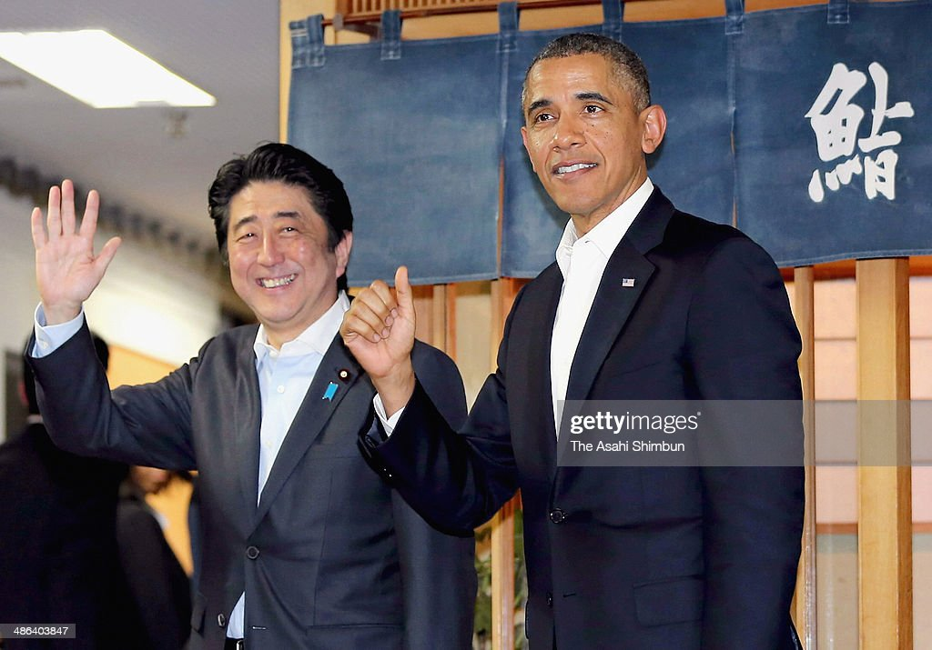 U.S. President Barack Obama and Japanese Prime Minister Shinzo Abe wave to media reporters in front of the three-star sushi restaurant 'Sukiyabashi Jiro' after their dinner on April 23, 2014 in Tokyo, Japan. The U.S. President is on an Asian tour where he is due to visit Japan, South Korea, Malaysia and Philippines..