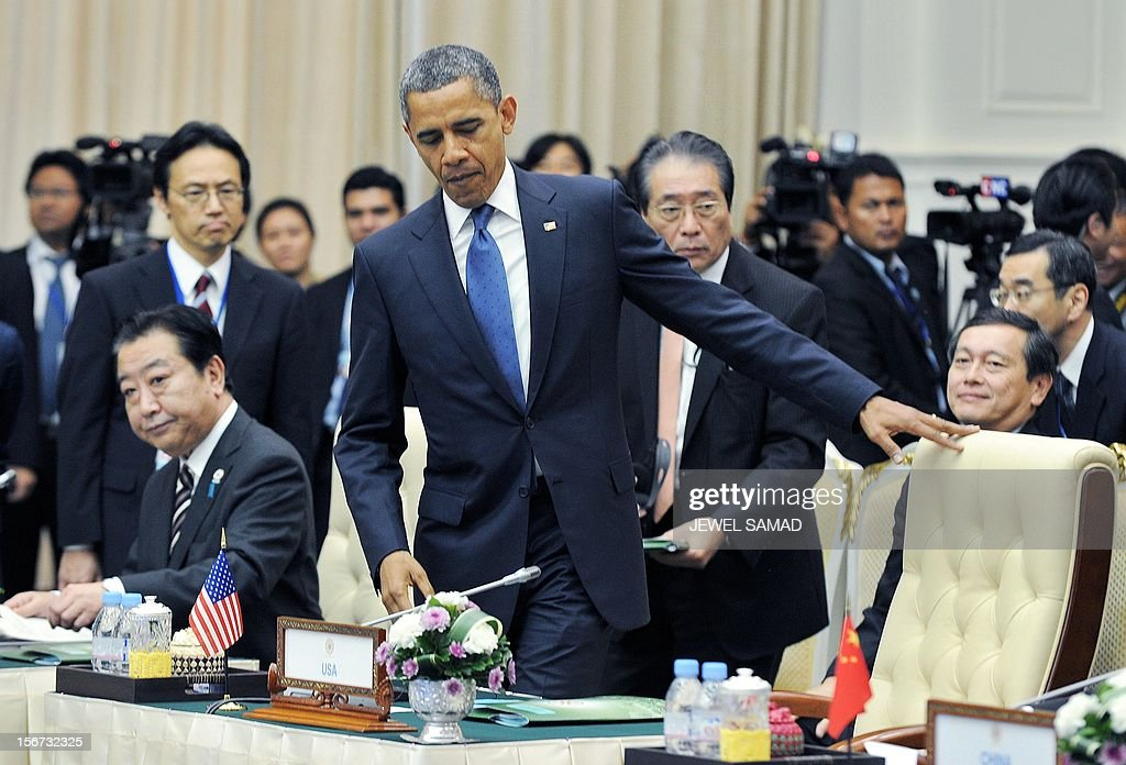 US President Barack Obama (C) and Japanese Prime Minister Yoshihiko Nodawith seat for an East Asian Summit Plenary Session at the Peace Palace in Phnom Penh on November 20, 2012. During the two-day East Asia Summit, Obama was scheduled to hold talks with the leaders of the 10-member Association of Southeast Asian Nations (ASEAN) along with Chinese Premier Wen Jiabao and Japan's Premier Yoshihiko Noda. AFP PHOTO Jewel Samad