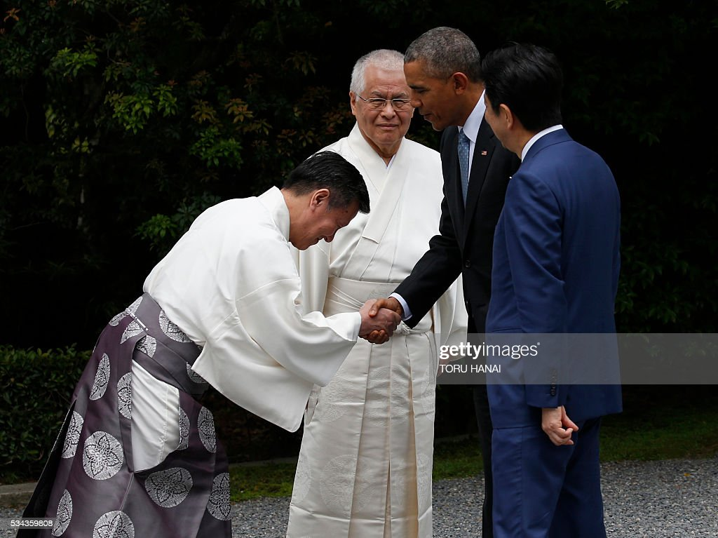 US President Barack Obama (2nd R) and Japan's Prime Minister Shinzo Abe are welcomed by Shinto priests as they visit Ise-Jingu Shrine in the city of Ise in Mie prefecture, on May 26, 2016, on the first day of the G7 leaders summit. World leaders kick off two days of G7 talks in Japan on May 26 with the creaky global economy, terrorism, refugees, China's controversial maritime claims, and a possible Brexit headlining their packed agenda. / AFP / POOL / TORU
