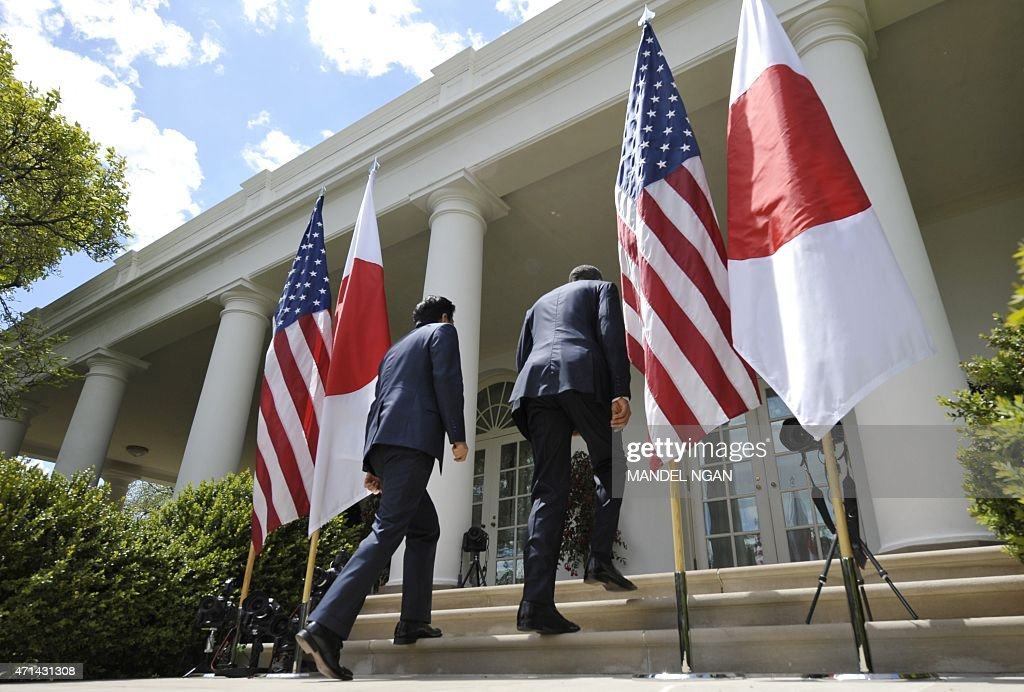 US President Barack Obama and Japan's Prime Minister Shinzo Abe depart folowing a joint press conference in the Rose Garden of the White House on...