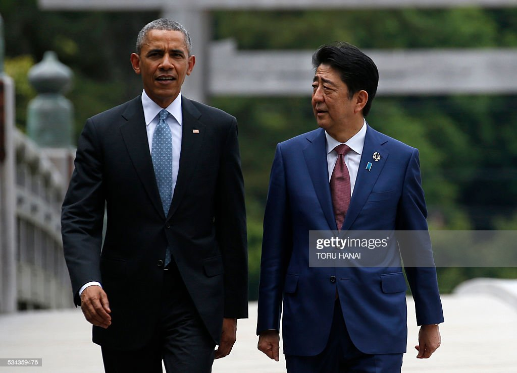 US President Barack Obama (L) and Japan's Prime Minister Shinzo Abe (R) speak as they visit Ise-Jingu Shrine in the city of Ise in Mie prefecture, on May 26, 2016, on the first day of the G7 leaders summit. World leaders kick off two days of G7 talks in Japan on May 26 with the creaky global economy, terrorism, refugees, China's controversial maritime claims, and a possible Brexit headlining their packed agenda. / AFP / POOL / TORU