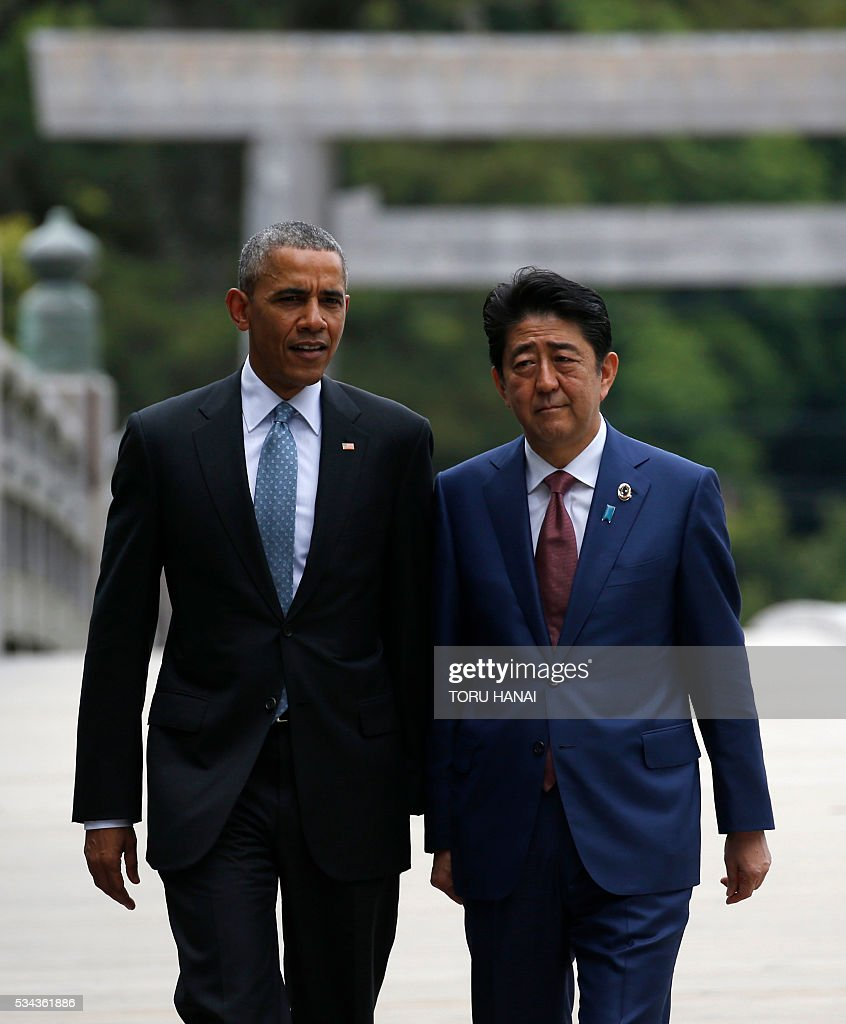 US President Barack Obama (L) and Japan's Prime Minister Shinzo Abe walk across Ujibashi bridge as they visit Ise-Jingu Shrine in the city of Ise in Mie prefecture, on May 26, 2016, on the first day of the G7 leaders summit. World leaders kick off two days of G7 talks in Japan on May 26 with the creaky global economy, terrorism, refugees, China's controversial maritime claims, and a possible Brexit headlining their packed agenda. / AFP / POOL / TORU