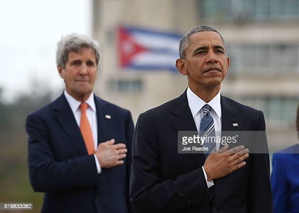 President Barack Obama and John Kerry US Secretary of State listen to the playing of the US National Anthem as they take part in a wreath laying...