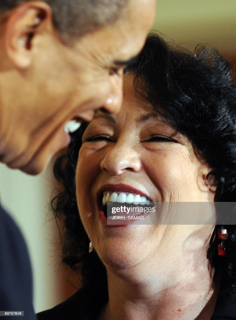 US President <a gi-track='captionPersonalityLinkClicked' href=/galleries/search?phrase=Barack+Obama&family=editorial&specificpeople=203260 ng-click='$event.stopPropagation()'>Barack Obama</a> and Justice Sonia Sotomayor laugh during a reception in the East Room at the White House on August 12, 2009. Sotomayor was sworn on August 8 in a public ceremony as a US Supreme Court justice, becoming the first Hispanic justice on the nation's highest bench. AFP PHOTO/Jewel SAMAD