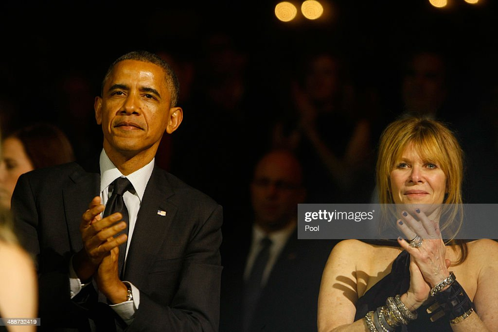 President Barack Obama and Kate Capshaw applaud as Steven Spielberg makes his speech during the Shoah Foundation's Ambassadors for Humanity gala at the Hyatt Regency Century Plaza Hotel on May 7, 2014 in Century City, California. U.S. President Barack Obama received the foundation's highest award for his global efforts to protect human rights, according to the foundation.