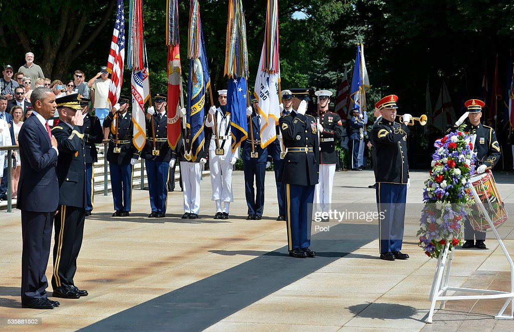 President Barack Obama (L) and Major General Bradley A. Becker (2nd L) stand at attention after Obama laid a wreath at the Tomb of the Unknown Soldier at Arlington National Cemetery on May 30, 2016 in Arlington, Virginia. Obama paid tribute to the nation's fallen military service members.