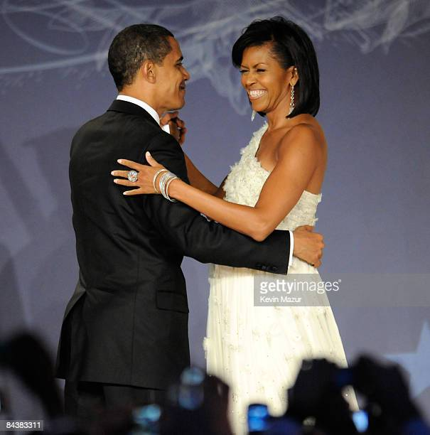 President Barack Obama and Michelle Obama dance at MTV and ServiceNation's 'Be the Change Live From The Inaugural Ball' at the Washington Hilton on...