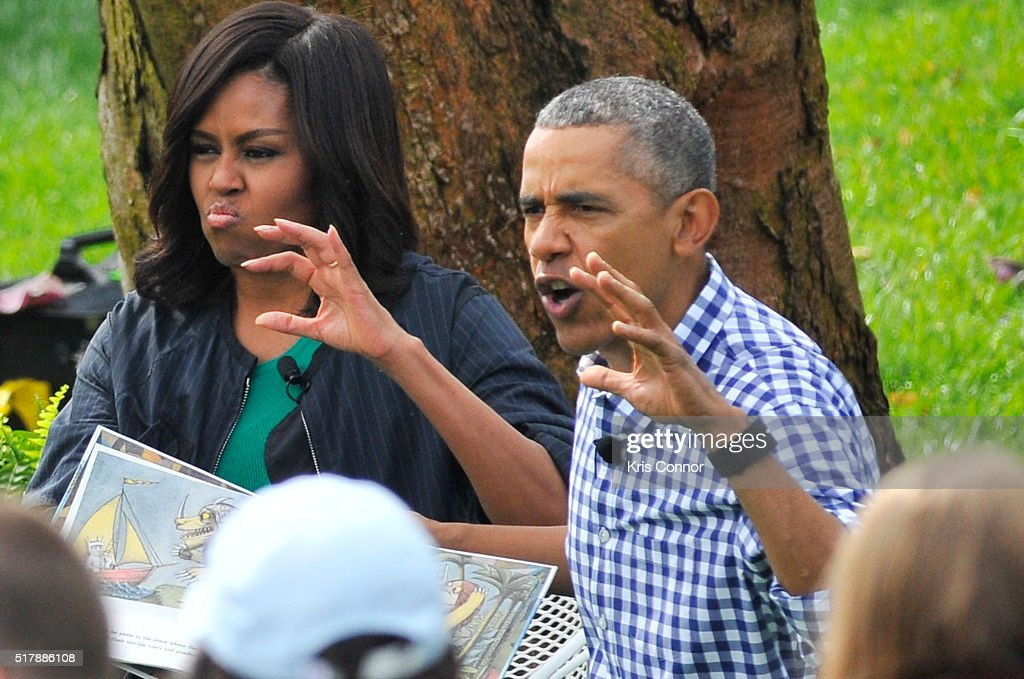 President Barack Obama and Michelle Obama read 'Where The Wild Things' during the 2016 White House Easter Egg Roll at the White House on March 28...
