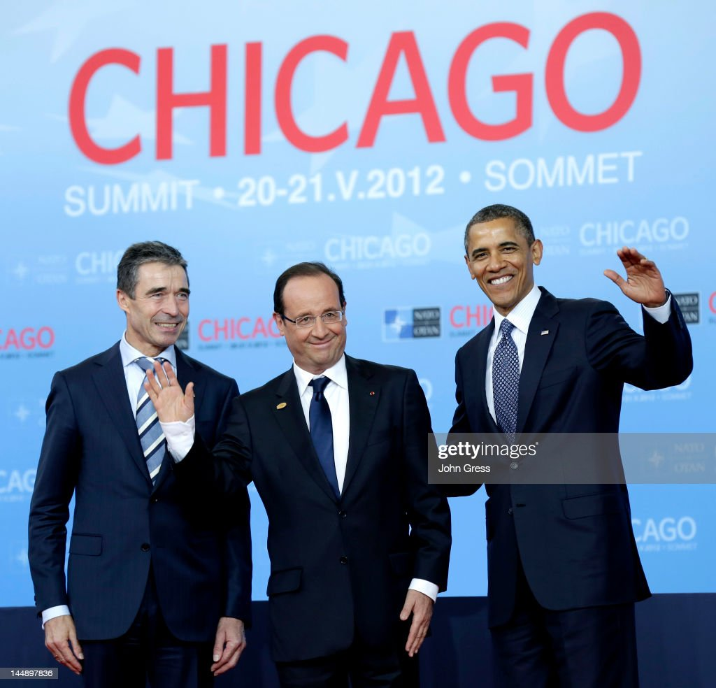 U.S. President Barack Obama (R) and NATO Secretary General Anders Fogh Rasmussen (L) greet French President Francois Hollande as he arrives at the NATO summit at McCormick Place on May 20, 2012 in Chicago, Illinois. As sixty heads of state converge for the two day summit that will address the situation in Afghanistan among other global defense issues, thousands of demonstrators have taken the streets to protest.