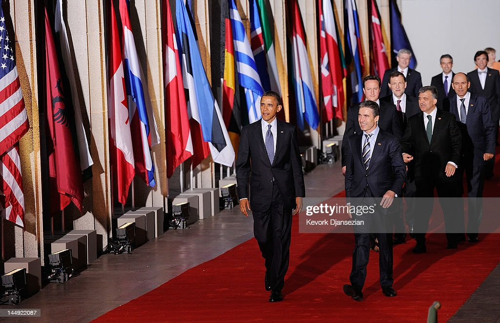 U.S. President <a gi-track='captionPersonalityLinkClicked' href=/galleries/search?phrase=Barack+Obama&family=editorial&specificpeople=203260 ng-click='$event.stopPropagation()'>Barack Obama</a> (L) and NATO Secretary General <a gi-track='captionPersonalityLinkClicked' href=/galleries/search?phrase=Anders+Fogh+Rasmussen&family=editorial&specificpeople=549374 ng-click='$event.stopPropagation()'>Anders Fogh Rasmussen</a> lead world leaders as they walk under the Soldier Field colonnades to the family photo during the NATO Summit on May 20, 2012 in Chicago, Illinois. As sixty heads of state converge for the two day summit that will address the situation in Afghanistan, among other global defense issues, thousands of demonstrators have taken to the streets to protest.