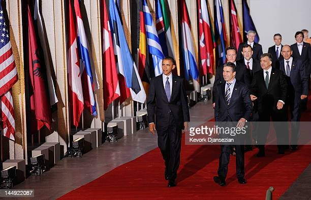 S President Barack Obama and NATO Secretary General Anders Fogh Rasmussen lead world leaders as they walk under the Soldier Field colonnades to the...