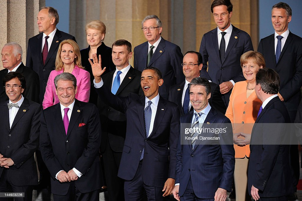 U.S. President Barack Obama (C) and NATO Secretary General Anders Fogh Rasmussen (2ndR) wave during the family photo under the Soldier Field colonnades at the NATO Summit on May 20, 2012 in Chicago, Illinois. As sixty heads of state converge for the two day summit that will address the situation in Afghanistan, among other global defense issues, thousands of demonstrators have taken to the streets to protest.