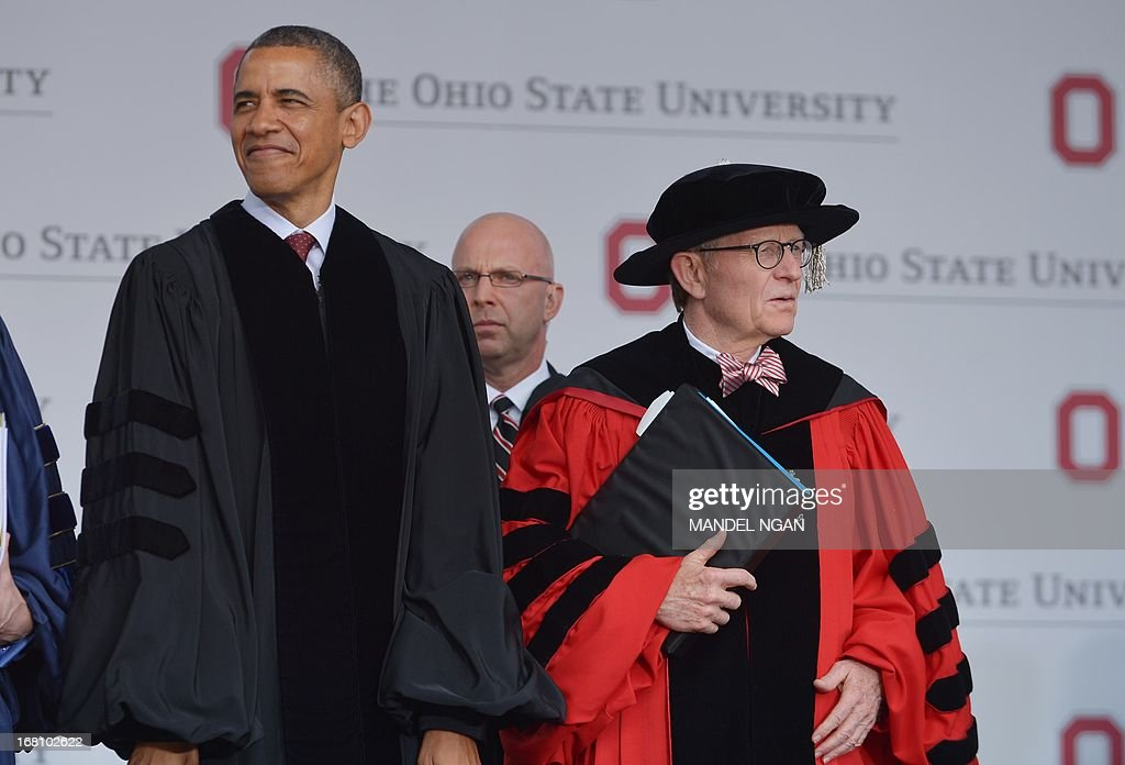 US President Barack Obama and Ohio State University President Gordon Gee arrive for the commencement ceremony at Ohio State University on May 5, 2013 in Columbus, Ohio. AFP PHOTO/Mandel NGAN
