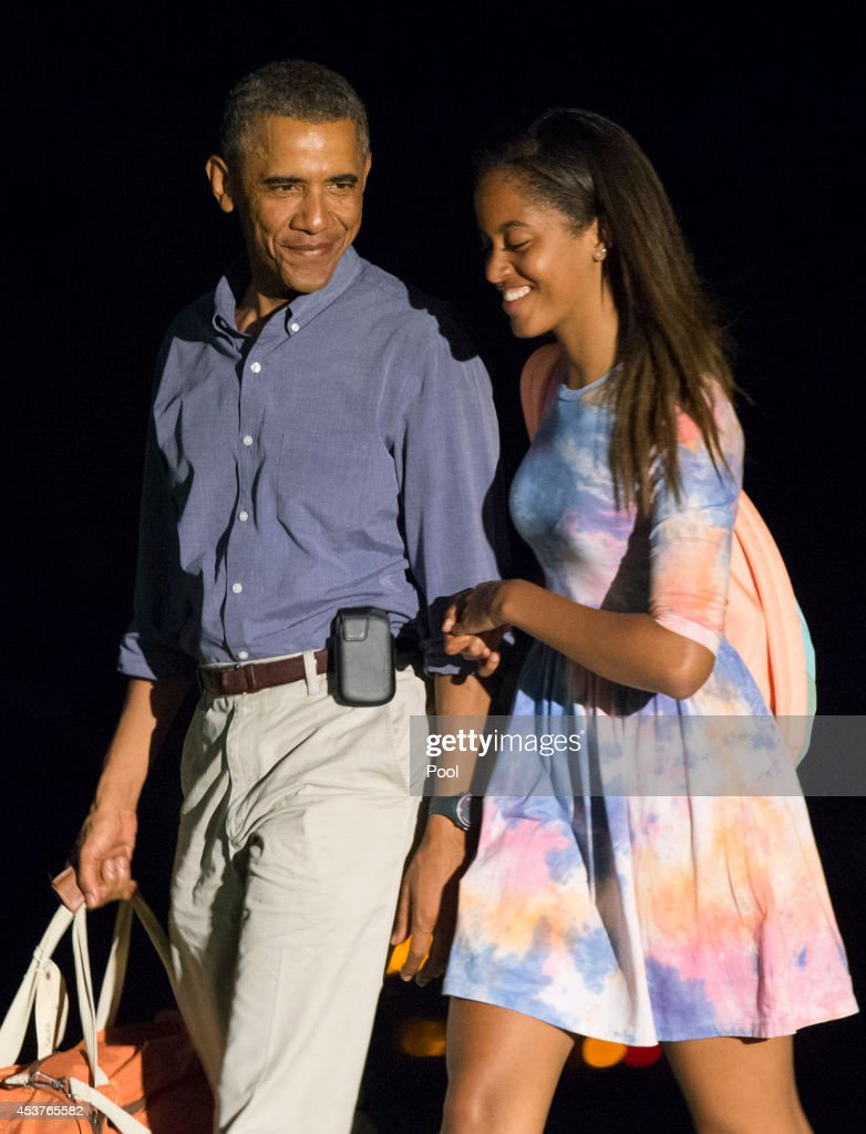 President <a gi-track='captionPersonalityLinkClicked' href=/galleries/search?phrase=Barack+Obama&family=editorial&specificpeople=203260 ng-click='$event.stopPropagation()'>Barack Obama</a> and oldest daughter Malia return to the White House on August 17, 2014 in Washington, DC. The president is taking a break from his vacation in Martha's Vineyard to attend a series of meetings at the White House.