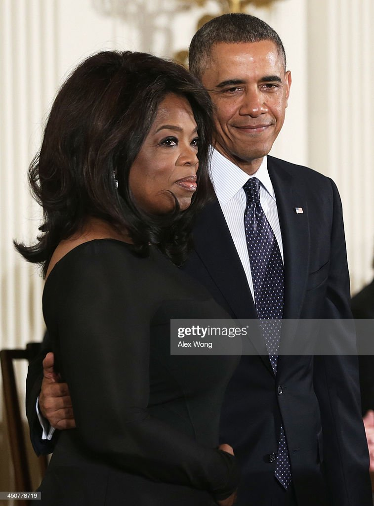 U.S. President Barack Obama (R) and Oprah Winfrey stand on stage before Winfrey receives the Presidential Medal of Freedom in the East Room at the White House on November 20, 2013 in Washington, DC. The Presidential Medal of Freedom is the nation's highest civilian honor, presented to individuals who have made meritorious contributions to the security or national interests of the United States, to world peace, or to cultural or other significant public or private endeavors.