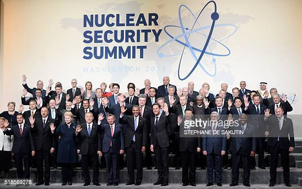 US President Barack Obama and other world leaders take part in the Nuclear Security Summit family photo at the Walter E Washington Convention Center...