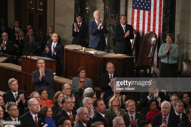 S President Barack Obama and others applaud for US Army Ranger Sergeant First Class Cory Remsburg as he is acknowledged during the State of the Union...