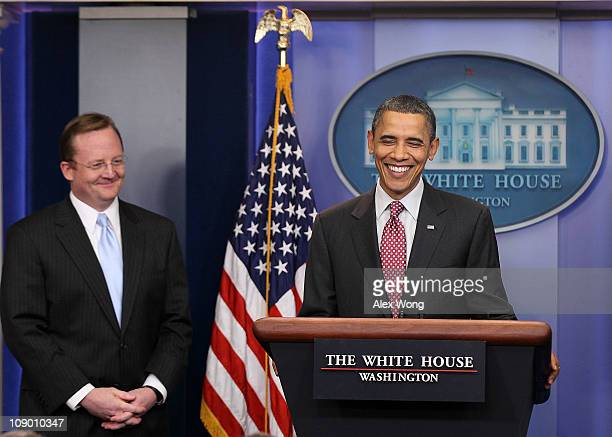 S President Barack Obama and outgoing White House Press Secretary Robert Gibbs smile during the daily press briefing February 11 2011 at the White...