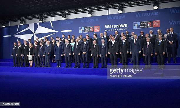US President Barack Obama and Polish President Andrzej Duda pose with other leaders at the start of a NATO summit on July 8 2016 at the Belweder...