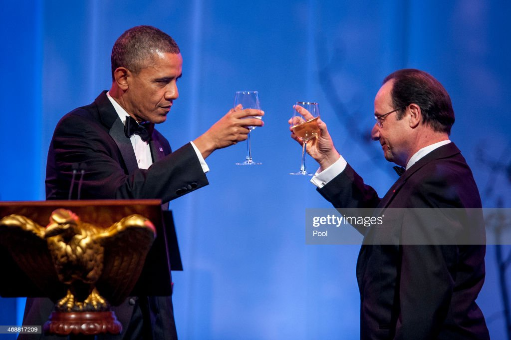 President <a gi-track='captionPersonalityLinkClicked' href=/galleries/search?phrase=Barack+Obama&family=editorial&specificpeople=203260 ng-click='$event.stopPropagation()'>Barack Obama</a> and President Francois Hollande of France toast each other at the beginning of the State Dinner in Hollande's honor on February 11, 2014 in Washington, DC. Obama and Hollande said the U.S. and France are embarking on a new, elevated level of cooperation as they confront global security threats in Syria and Iran, deal with climate change and expand economic cooperation.