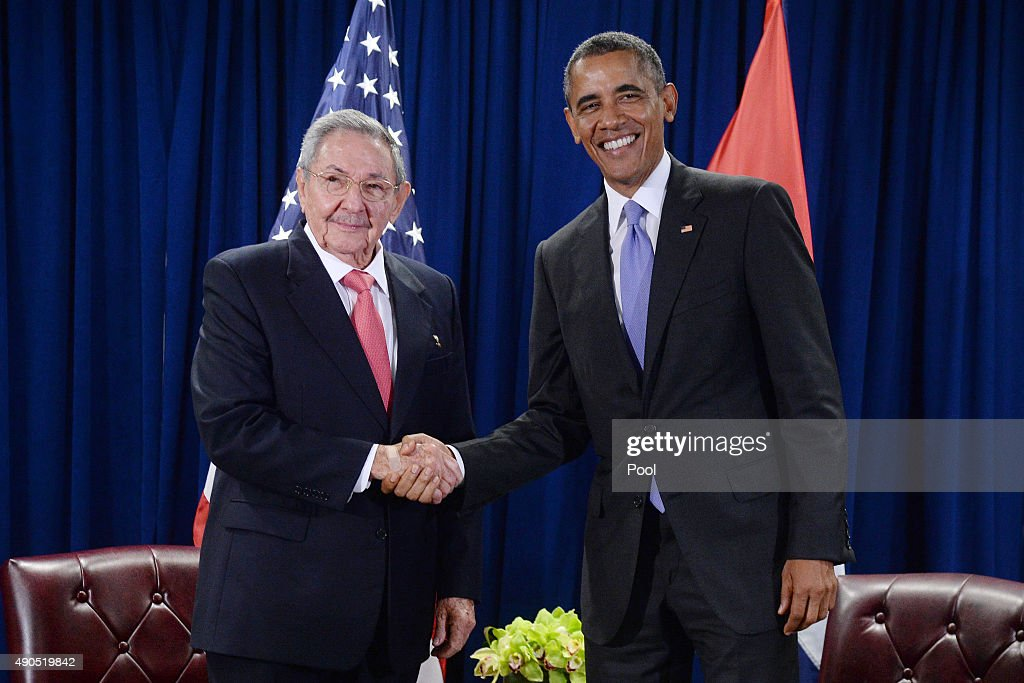 S President Barack Obama and President Raul Castro of Cuba shake hands during a bilateral meeting at the United Nations Headquarters on September 29...