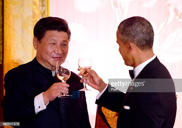 President Barack Obama and President Xi Jinping of China exchange toasts during a state dinner at the White House September 25 2015 in Washington DC...