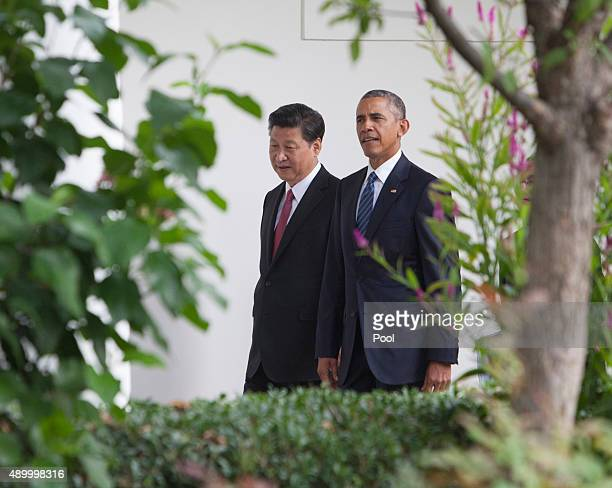 President Barack Obama and President XI Jinping of China walk to the Oval Office after participating in an official State Visit on the South Lawn of...