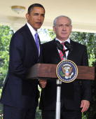 S President Barack Obama and Prime Minister Benjamin Netanyahu of Israel shake hands after making a statement on the killings in the West Bank after...
