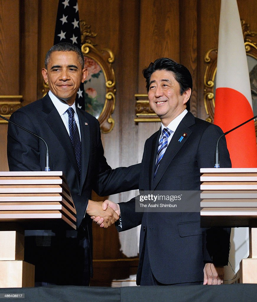 U.S. President <a gi-track='captionPersonalityLinkClicked' href=/galleries/search?phrase=Barack+Obama&family=editorial&specificpeople=203260 ng-click='$event.stopPropagation()'>Barack Obama</a> and Prime Minister of Japan <a gi-track='captionPersonalityLinkClicked' href=/galleries/search?phrase=Shinzo+Abe&family=editorial&specificpeople=559017 ng-click='$event.stopPropagation()'>Shinzo Abe</a> shake hands during a joint news conference after their meeting at the State Guest House on April 24, 2014 in Tokyo, Japan. The U.S. President is on an Asian tour where he is due to visit Japan, South Korea, Malaysia and Philippines.