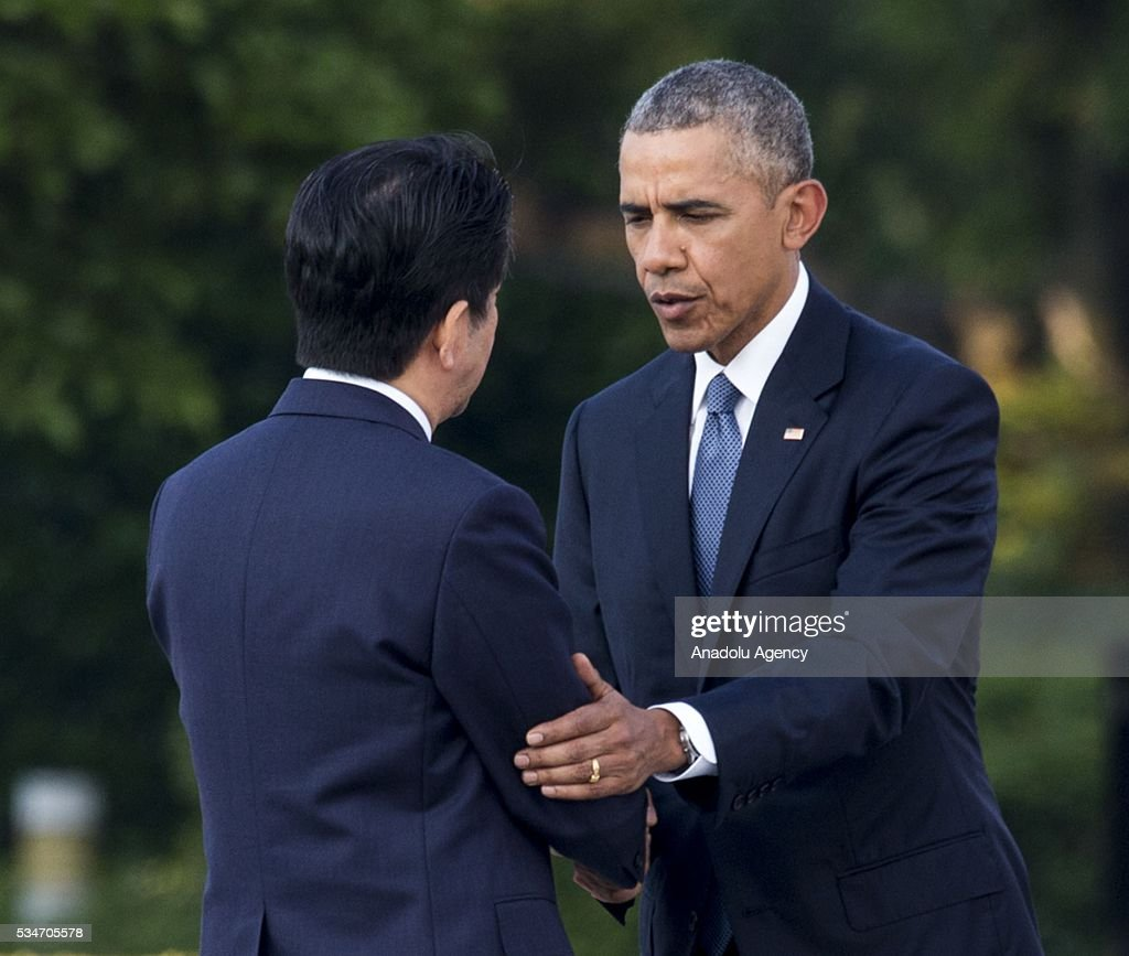 U.S. President Barack Obama (R) and Prime Minister of Japan Shinzo Abe (L) shake hands during their visit to the cenotaph at Hiroshima Peace Memorial Park to respect to the families of victims, killed by an atomic bomb in Hiroshima, Japan on May 27, 2016. US President Barack Obama is the first American president, visiting Hiroshima after United States of America dropped Atomic bomb in Hiroshima on August 6, 1945.