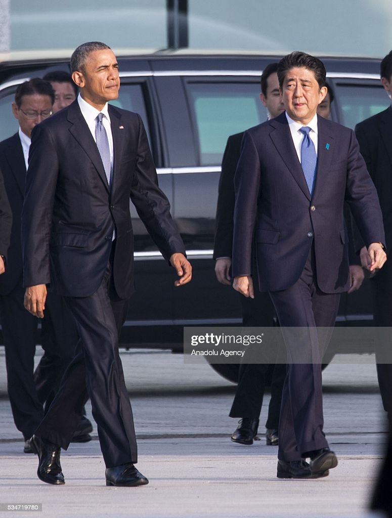 U.S. President Barack Obama (L) and Prime Minister of Japan Shinzo Abe (R) walk towards the cenotaph at Hiroshima Peace Memorial Park to respect to the families of victims, killed by an atomic bomb in Hiroshima, Japan on May 27, 2016. US President Barack Obama is the first American president, visiting Hiroshima after United States of America dropped Atomic bomb in Hiroshima on August 6, 1945.