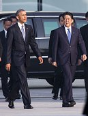 S President Barack Obama and Prime Minister of Japan Shinzo Abe walk towards the cenotaph at Hiroshima Peace Memorial Park to respect to the families...