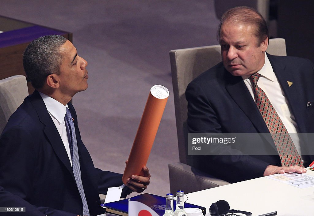 US President <a gi-track='captionPersonalityLinkClicked' href=/galleries/search?phrase=Barack+Obama&family=editorial&specificpeople=203260 ng-click='$event.stopPropagation()'>Barack Obama</a> and Prime Minister of Pakistan Muhammad <a gi-track='captionPersonalityLinkClicked' href=/galleries/search?phrase=Nawaz+Sharif&family=editorial&specificpeople=217726 ng-click='$event.stopPropagation()'>Nawaz Sharif</a> look at a gift as they attend the opening session of the at the 2014 Nuclear Security Summit on March 24, 2014 in The Hague, Netherlands. The Nuclear Security Summit, held March 24-25, will be attended by world leaders and is aimed at preventing nuclear terrorism.