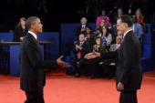S President Barack Obama and Republican presidential candidate Mitt Romney shake hands after a town hall style debate at Hofstra University October...
