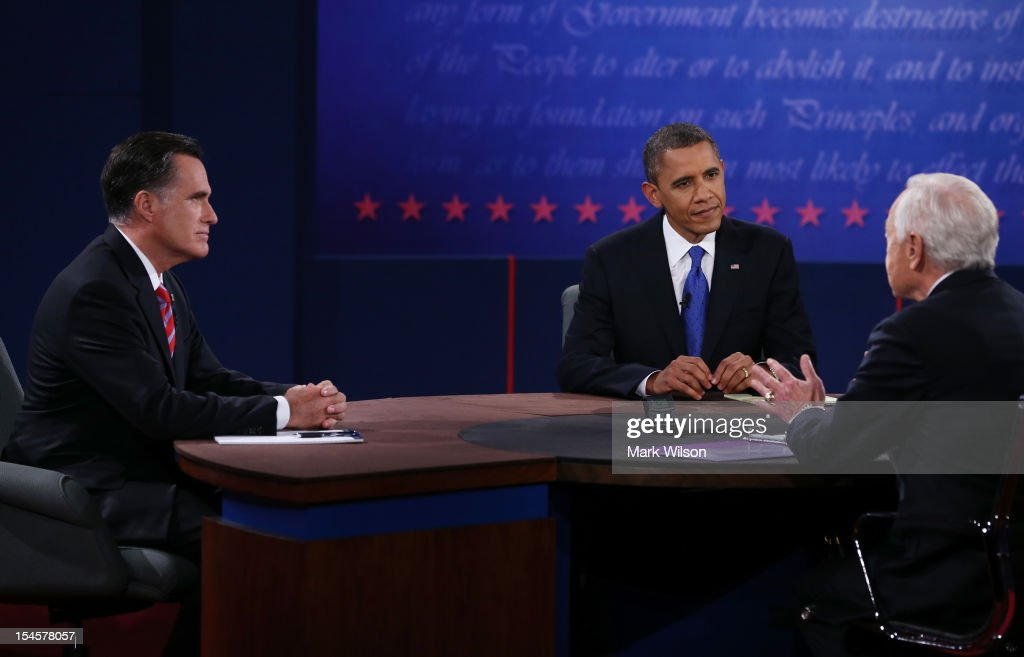S President Barack Obama and Republican presidential candidate Mitt Romney listen as moderator Bob Schieffer of CBS speaks at the Keith C and Elaine...