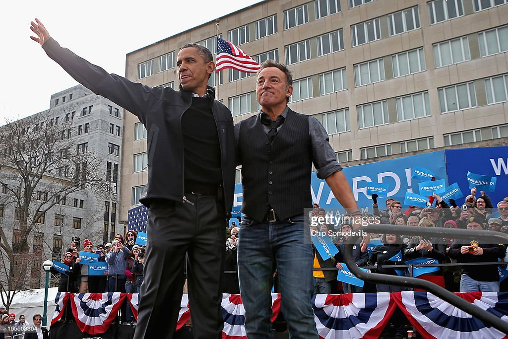 U.S. President <a gi-track='captionPersonalityLinkClicked' href=/galleries/search?phrase=Barack+Obama&family=editorial&specificpeople=203260 ng-click='$event.stopPropagation()'>Barack Obama</a> and rocker <a gi-track='captionPersonalityLinkClicked' href=/galleries/search?phrase=Bruce+Springsteen&family=editorial&specificpeople=123832 ng-click='$event.stopPropagation()'>Bruce Springsteen</a> wave to a crowd of 18,000 people during a rally on the last day of campaigning in the general election November 5, 2012 in Madison, Wisconsin. Obama and his opponent, Republican presidential nominee and former Massachusetts Gov. Mitt Romney are stumping from one 'swing state' to the next in a last-minute rush to persuade undecided voters.