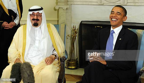 S President Barack Obama and Saudi Arabian King Abdullah BinAbdalAziz Al Saud laugh as they speak to the media after their meeting in the Oval Office...