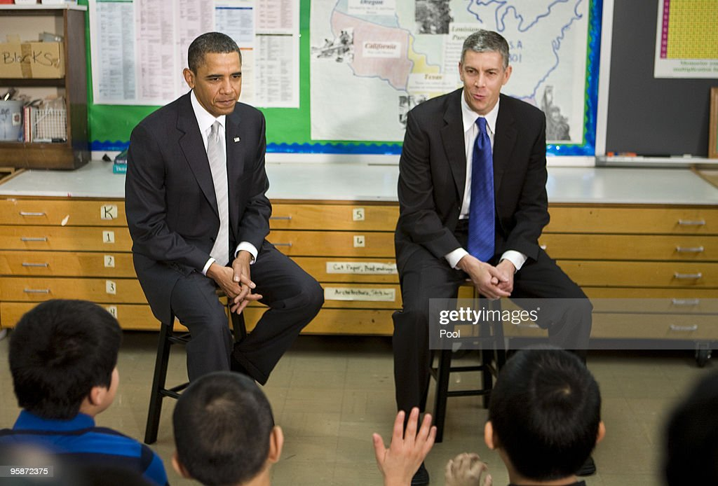 U.S. President <a gi-track='captionPersonalityLinkClicked' href=/galleries/search?phrase=Barack+Obama&family=editorial&specificpeople=203260 ng-click='$event.stopPropagation()'>Barack Obama</a> and Secretary of Education <a gi-track='captionPersonalityLinkClicked' href=/galleries/search?phrase=Arne+Duncan&family=editorial&specificpeople=3049193 ng-click='$event.stopPropagation()'>Arne Duncan</a> (R) visits with sixth grade students at the Graham Road Elementary School January 19, 2010 in Falls Church, Virginia. Following his meeting with students the President will deliver remarks on his 'Race to the Top' program and his request for an additional $1.35 billion in 2011 for the program.