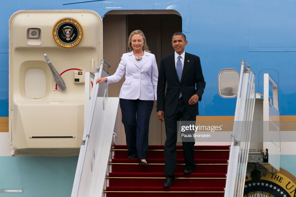 US President Barack Obama and Secretary of State Hillary Clinton arrive at Yangon International airport during his historical first visit to the country on November 19, 2012 in Yangon, Myanmar. Obama is the first US President to visit Myanmar while on a four-day tour of Southeast Asia that also includes Thailand and Cambodia.