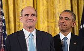 US President Barack Obama and singer/songwriter James Taylor attend a Presidential Medal of Freedom ceremony at the White House in Washington DC on...