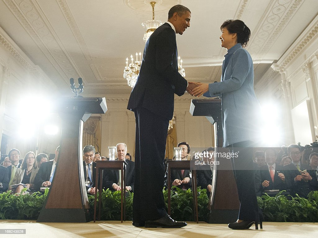 US President Barack Obama and South Korean President Park Geun-hye shake hands following a joint press conference in the East Room of the White House in Washington, DC, on May 7, 2013. AFP PHOTO / Saul LOEB