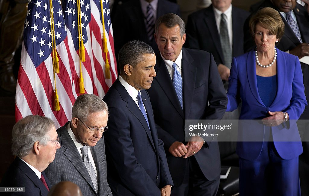U.S. President <a gi-track='captionPersonalityLinkClicked' href=/galleries/search?phrase=Barack+Obama&family=editorial&specificpeople=203260 ng-click='$event.stopPropagation()'>Barack Obama</a> (C) and Speaker of the House <a gi-track='captionPersonalityLinkClicked' href=/galleries/search?phrase=John+Boehner&family=editorial&specificpeople=274752 ng-click='$event.stopPropagation()'>John Boehner</a> (R-OH) (2nd R) take part in a ceremony to unveil a statue honoring the late civil rights activist Rosa Parks in Statutory Hall of the U.S. Capitol February 27, 2013 in Washington, DC. Obama was joined by congressional leaders including (L-R) Senate Minority Leader <a gi-track='captionPersonalityLinkClicked' href=/galleries/search?phrase=Mitch+McConnell&family=editorial&specificpeople=217985 ng-click='$event.stopPropagation()'>Mitch McConnell</a> (R-KY), Senate Majority Leader <a gi-track='captionPersonalityLinkClicked' href=/galleries/search?phrase=Harry+Reid+-+Politician&family=editorial&specificpeople=203136 ng-click='$event.stopPropagation()'>Harry Reid</a> (D-NV) and House Minority Leader <a gi-track='captionPersonalityLinkClicked' href=/galleries/search?phrase=Nancy+Pelosi&family=editorial&specificpeople=169883 ng-click='$event.stopPropagation()'>Nancy Pelosi</a> (D-CA).