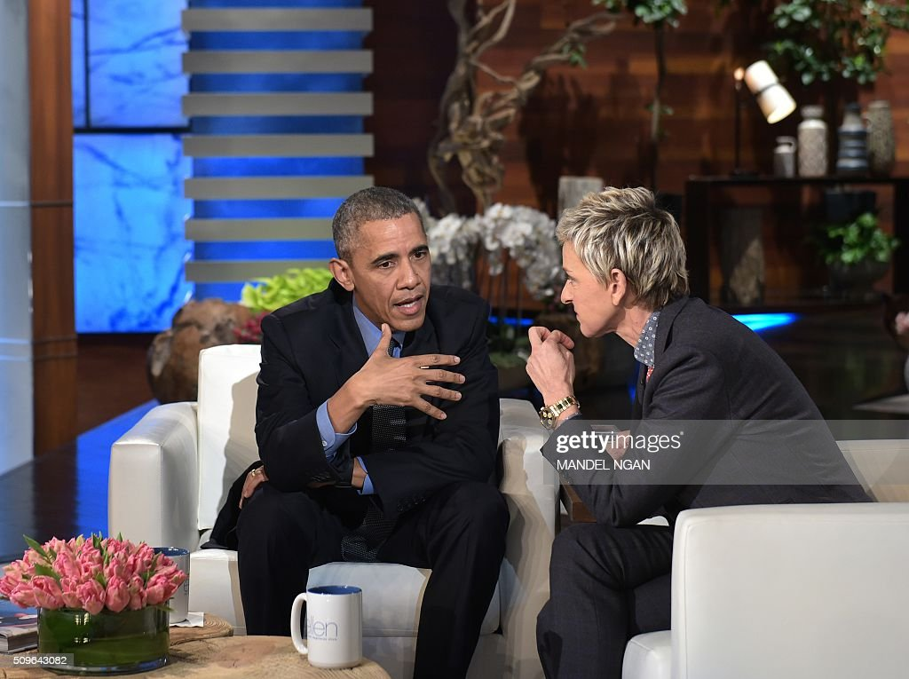 US President Barack Obama and talk show host Ellen DeGeneres are seen during a break in the taping of The Ellen DeGeneres show at Warner Brothers Studios in Burbank, California on February 11, 2016. / AFP / Mandel Ngan