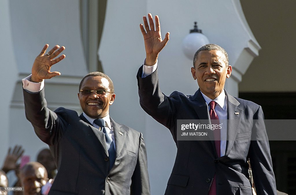 President Barack Obama (R) and Tanzanian President Jakaya Kikwete wave to thew crowd as they participate in an arrival ceremony at the State House in Dar es Salaam, Tanzania, on July 1, 2013.