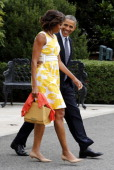 US President Barack Obama and the first lady Michelle Obama depart the White House en route Joint Base Andrews August 10 2013 in Washington DC The...