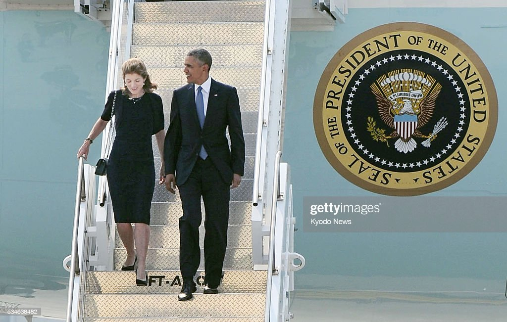 U.S. President Barack Obama (R) and U.S. Ambassador to Japan Caroline Kennedy arrive at the Marine Corps' Air Station Iwakuni in the western Japanese city on May 27, 2016. Obama will visit Hiroshima later in the day to become the first American head of state to do so since the United States dropped an atomic bomb on the city in August 1945.
